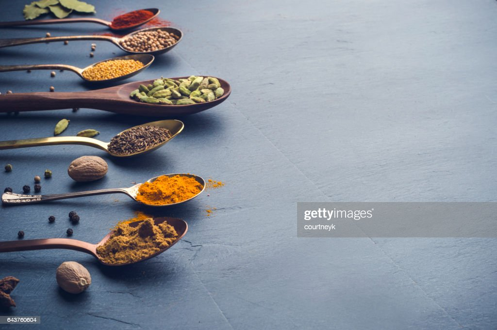 Variety of herbs and spices on slate background. : Stock Photo