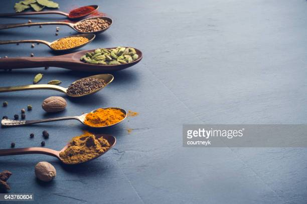 variety of herbs and spices on slate background. - cultures stock pictures, royalty-free photos & images