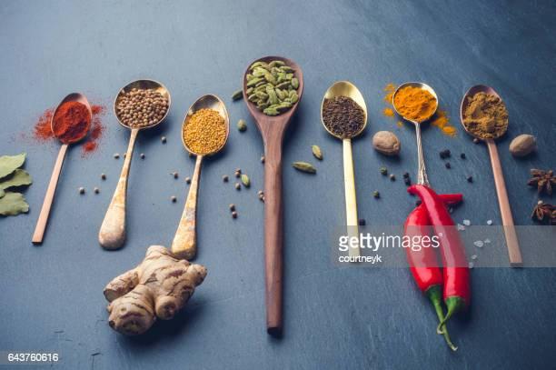 variety of herbs and spices on slate background. - fiore di zenzero foto e immagini stock