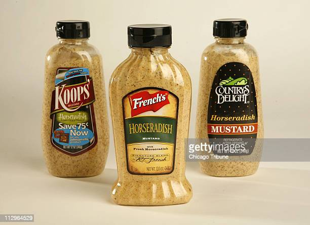 A variety of horseradish mustards sit on display including from left Koops' French's and Countrys Delight