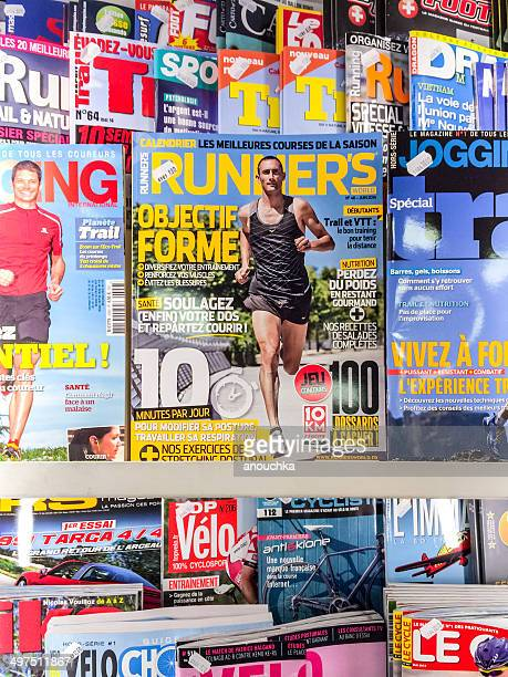 variety of magazines for sale on newsstand, geneva, switzerland - magazine rack stock photos and pictures