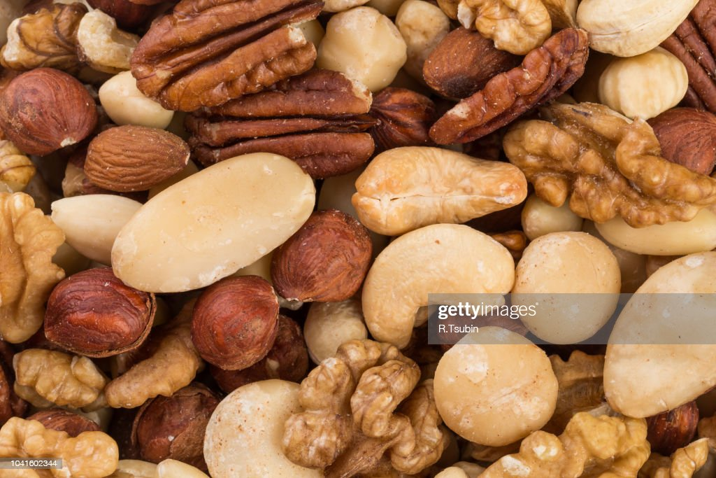 Variety of Mixed Nuts as a background - close up image : Stock Photo