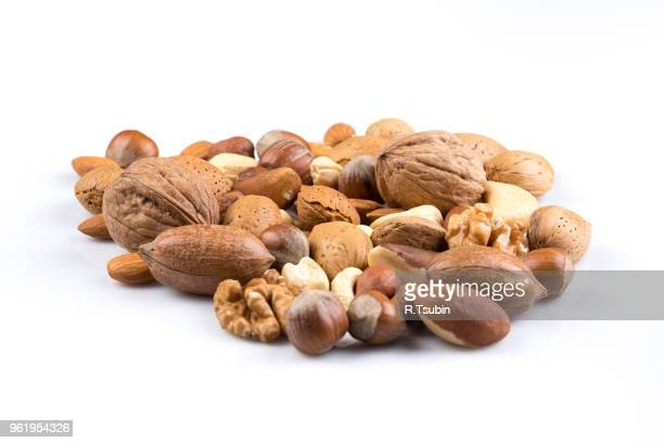 variety of mixed nuts isolated on white background - brazil nut fotografías e imágenes de stock