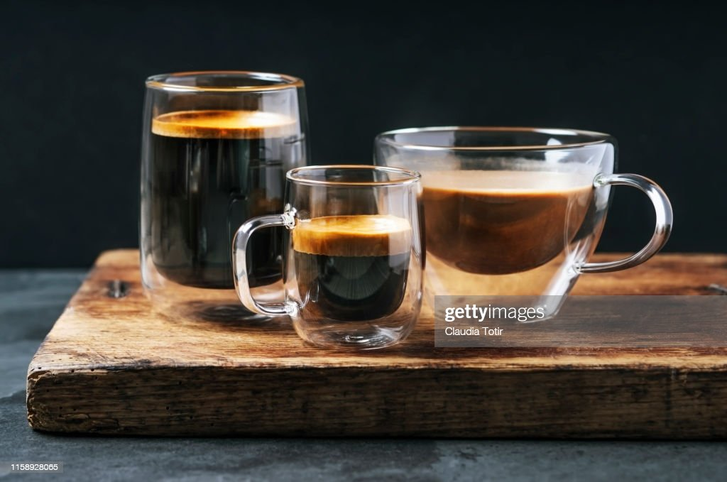 Variety of mugs with coffee and espresso on black background : Stock Photo