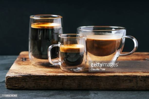 variety of mugs with coffee and espresso on black background - caffeine stock pictures, royalty-free photos & images