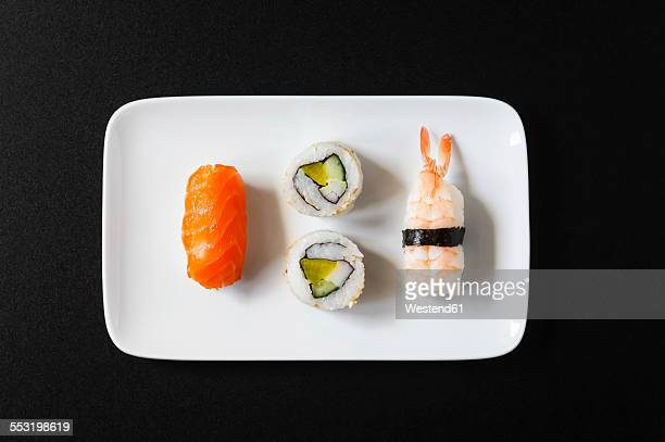 variety of nigiri sushi and inside-out on plate - nigiri stock pictures, royalty-free photos & images