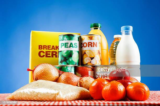 Variety of packaged and basic foods against blue