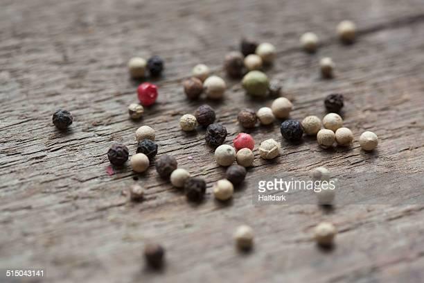 variety of peppercorns on wooden table - pimienta fotografías e imágenes de stock