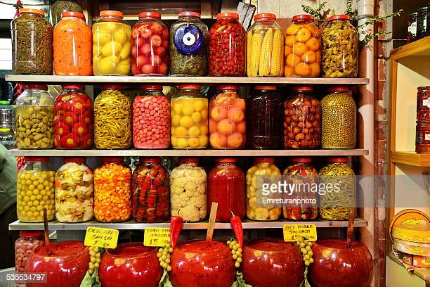 variety of pickled vegetables for sale - emreturanphoto stockfoto's en -beelden