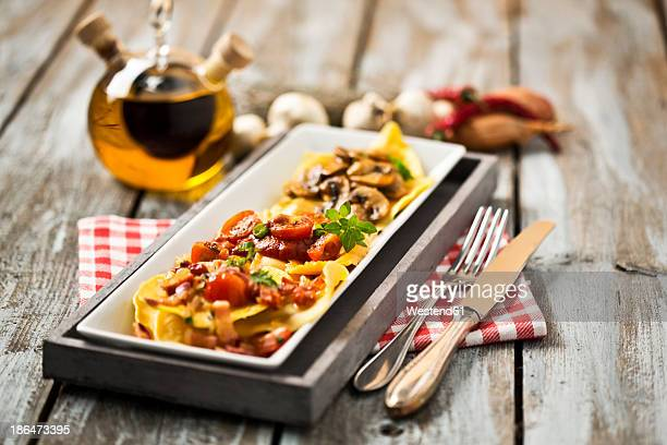 Variety of ravioli filled with tomato, ham and mushrooms on plate