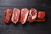 Variety of Raw Black Angus Prime meat steaks