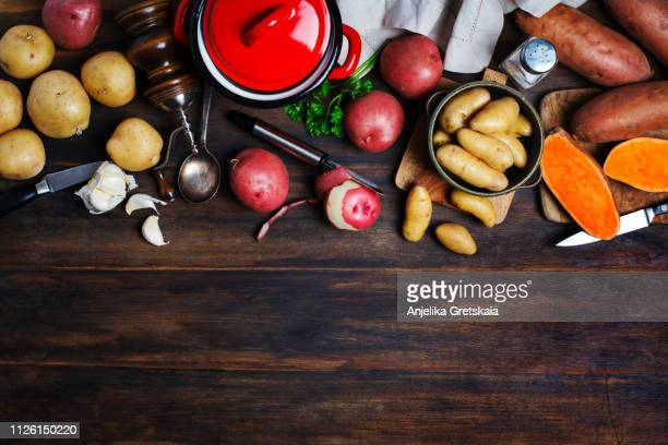 variety of raw uncooked organic potatoes: red, white, sweet  and fingers potatoes over wooden background - cooking utensil stock pictures, royalty-free photos & images