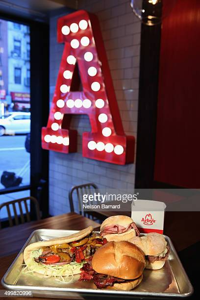 A variety of sandwiches are sampled as Arby's gives fans a sneak peek at its new Manhattan restaurant at 40th St and 8th Ave on December 3 2015 in...