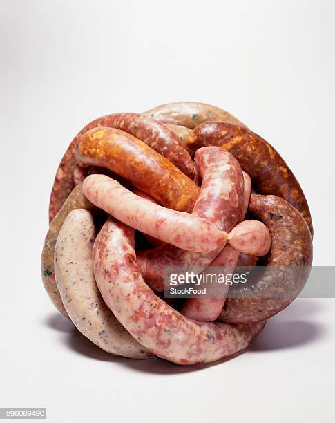 Variety of Sausages in a Ball; White Background