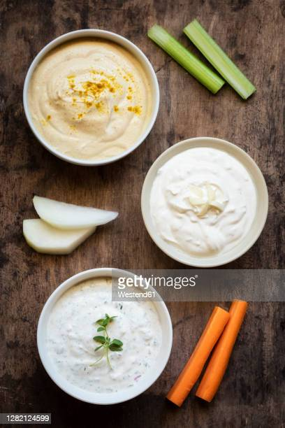variety of sour cream with vegetable stick on table - sauce photos et images de collection