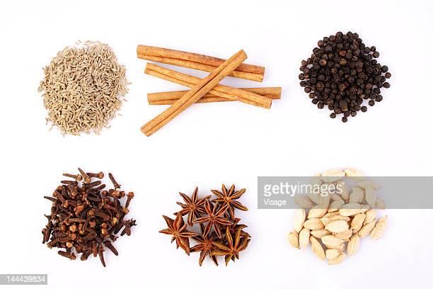 variety of spices on a tabletop - gewürznelke stock-fotos und bilder