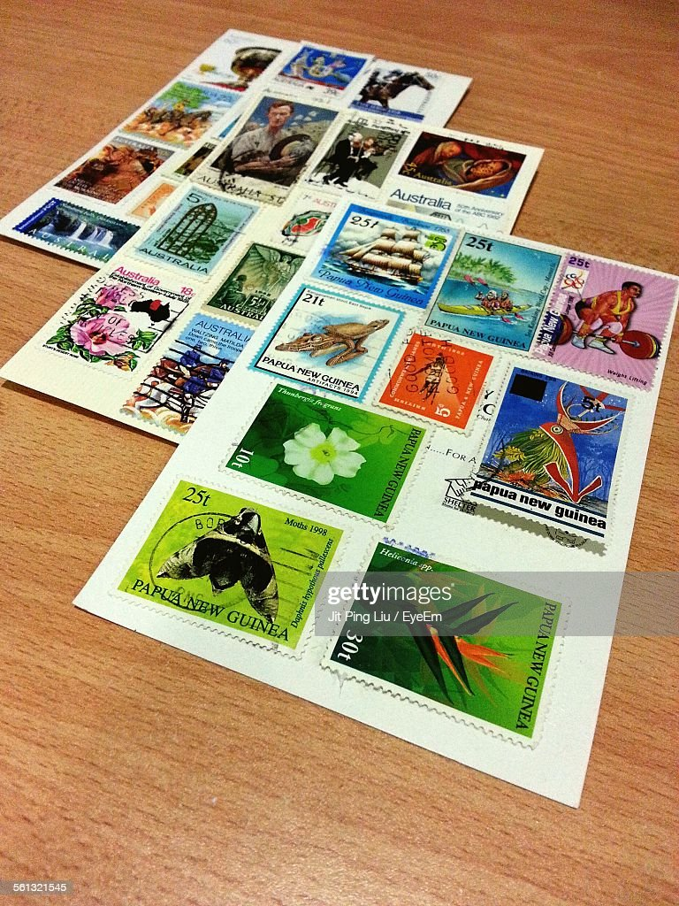 Variety Of Stamps On Wooden Table : Stock Photo
