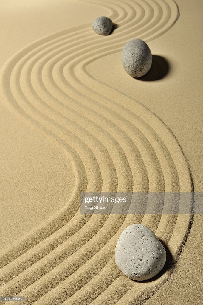 A variety of stones and wave pattern in the sand p : ストックフォト