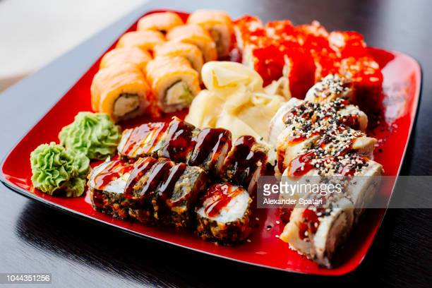 Variety of sushi rolls on a plate in Japanese restaurant