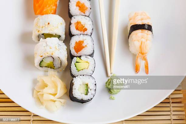 Variety of sushi with wasabi and ginger on plate
