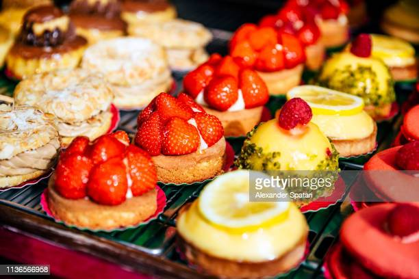 Variety of sweet desserts at patisserie display