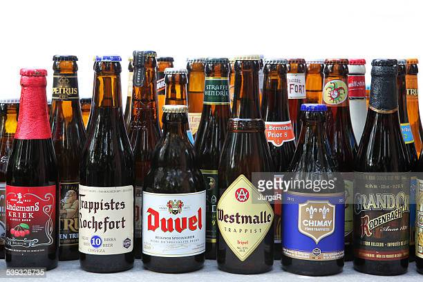 variety of traditional belgian beer in bottles - belgië stockfoto's en -beelden