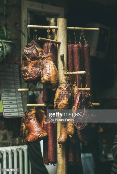 variety of traditional hungarian smoked meat and sausages at a  farmers market. - traditionally hungarian stock pictures, royalty-free photos & images