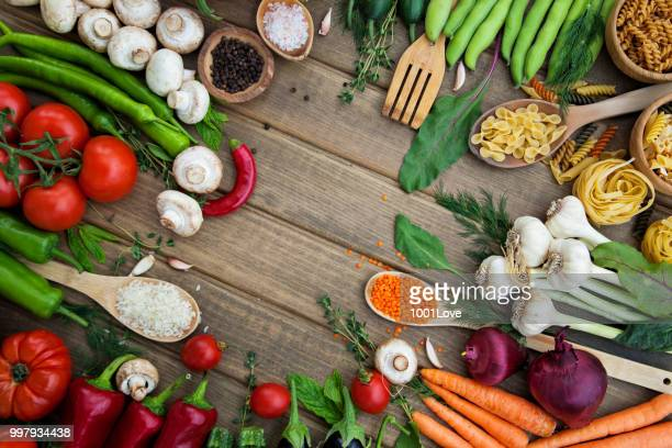 Variety of vegetables on wooden background.