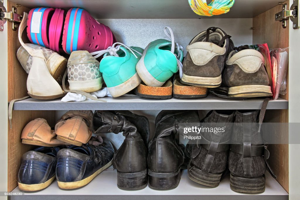 Variety of women and men shoes in a wardrobe : Stock Photo
