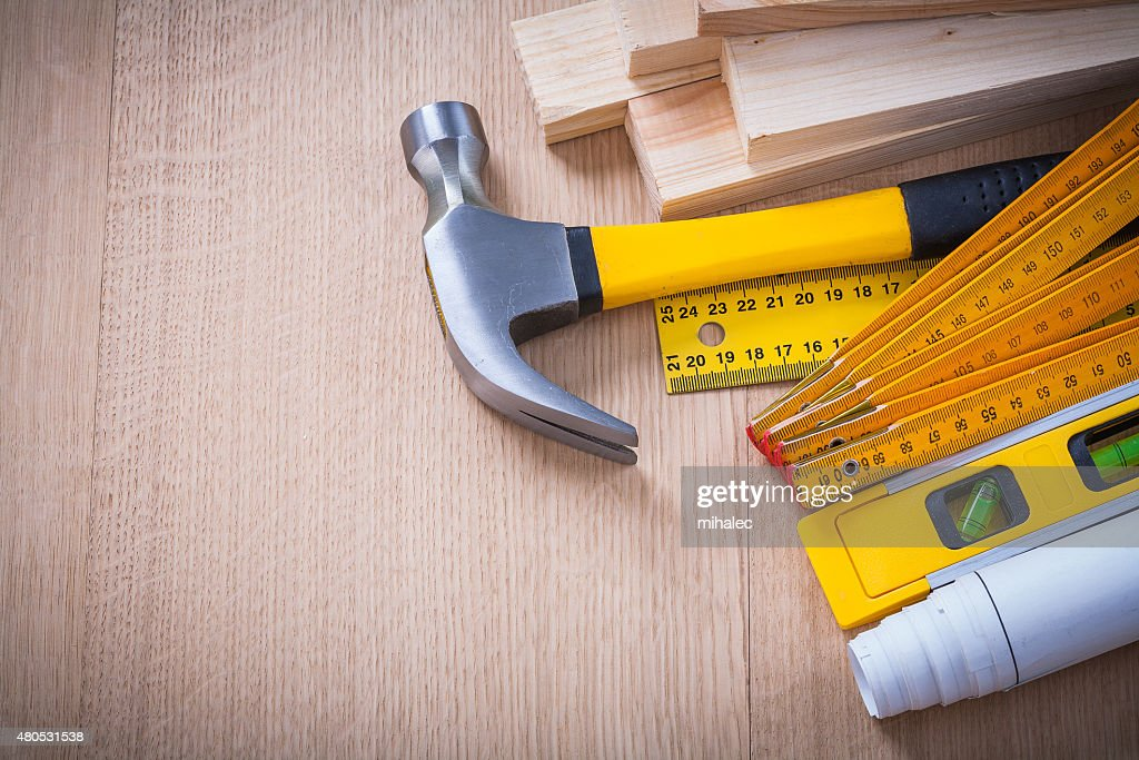 Variety of working building tools on wood board horizontal versi : Stock Photo