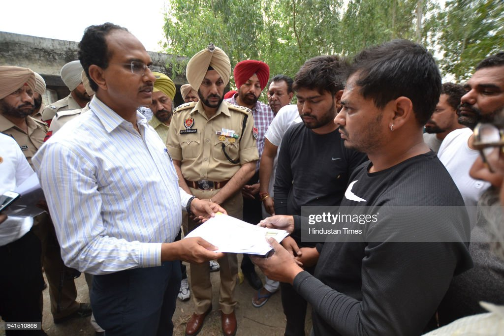 Varinder Kumar Sharma along with SSP GPS Bhullar handing over death certificate of Balwant Rai who was killed by the Islamic State terror group in...