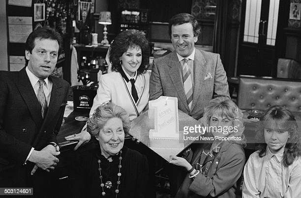 Various actors from the television soap opera Eastenders celebrate the first anniversary of the show with Terry Wogan in the Queen Victoria pub at...