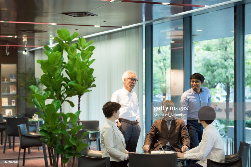 Various age Asian business team are meeting around the table : Stock Photo