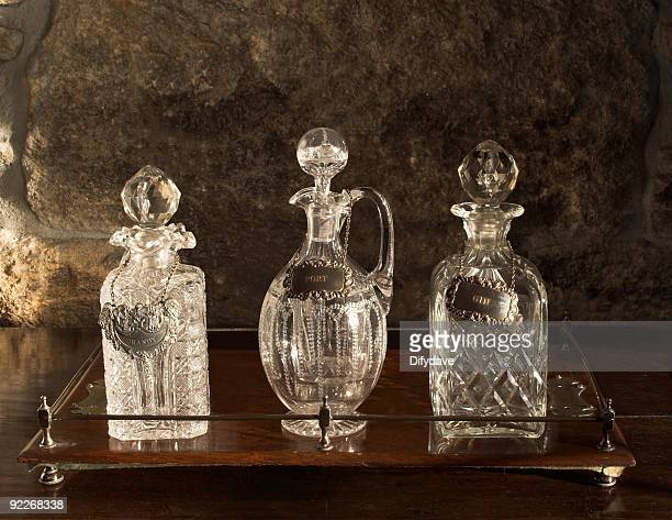 Various Antique Glass Decanters On Wooden Tray