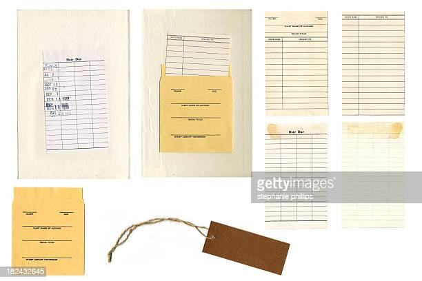 Various Antique Library Cards on a White Background