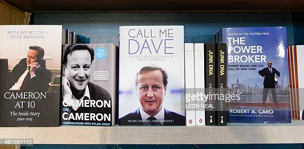 Various biographies of British Prime Minister David Cameron including Call Me Dave by Michael Ashcroft and Isabel Oakeshott are displayed in the...