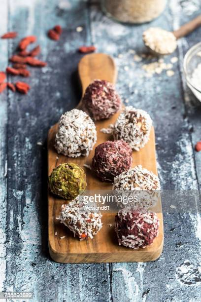 Various Bliss Balls on wooden board