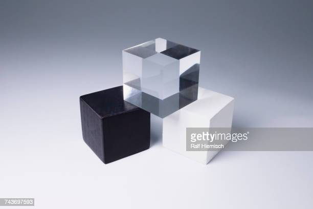 Various block shapes arranged in stack on gray background