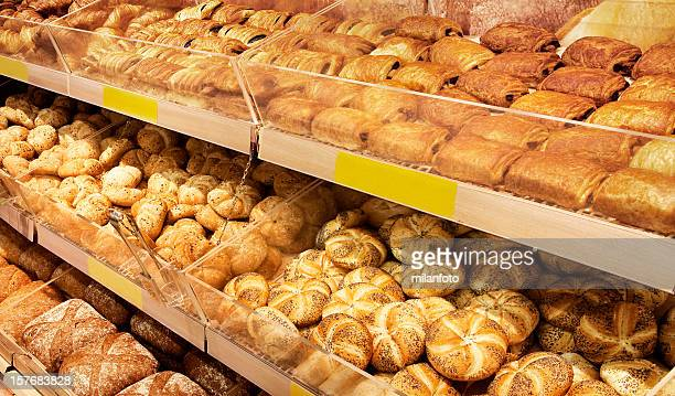 Various breads sitting on a large shelf