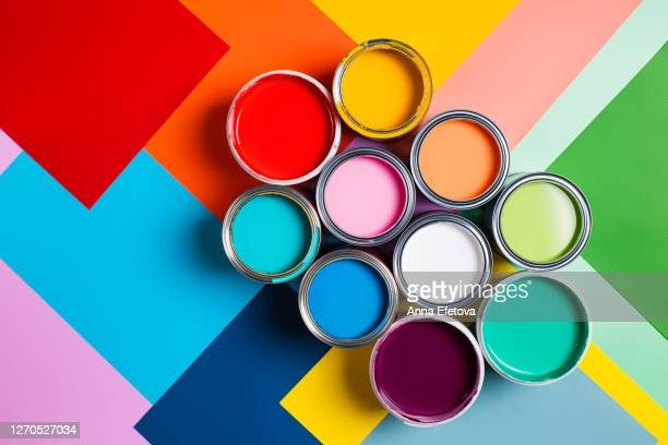 various bright paints on colorful background - artist's palette stock pictures, royalty-free photos & images