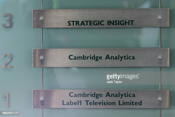 Various business signs are pictured inside the London headquarters of Cambridge Analytica on New Oxford Street in central London on March 20, 2018 in...