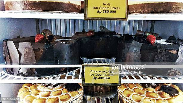 Various Cakes Displayed On Shelves At Bakery Shop