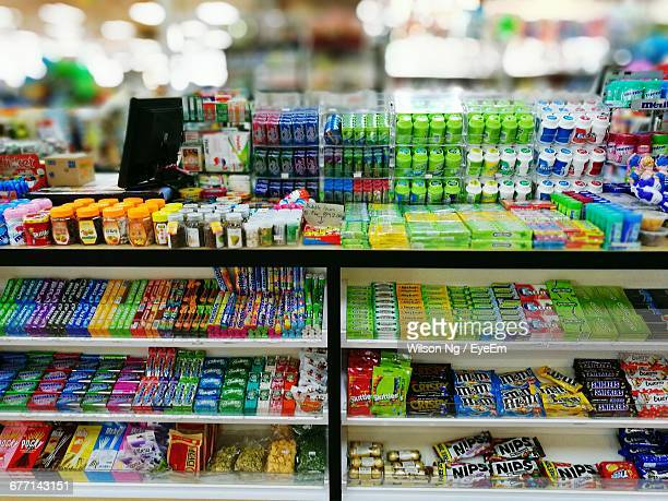 Various Candies On Shelf For Sale At Store