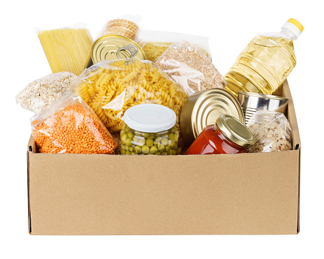 Various canned food, pasta and cereals in a cardboard box. 1161719598
