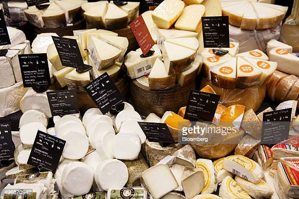 Various cheeses are displayed for sale in the specialty foods section of the new Whole Foods Market Inc store in downtown Los Angeles California US...