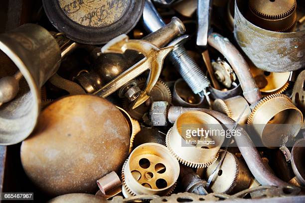 Various clock parts within a clock makers workshop.
