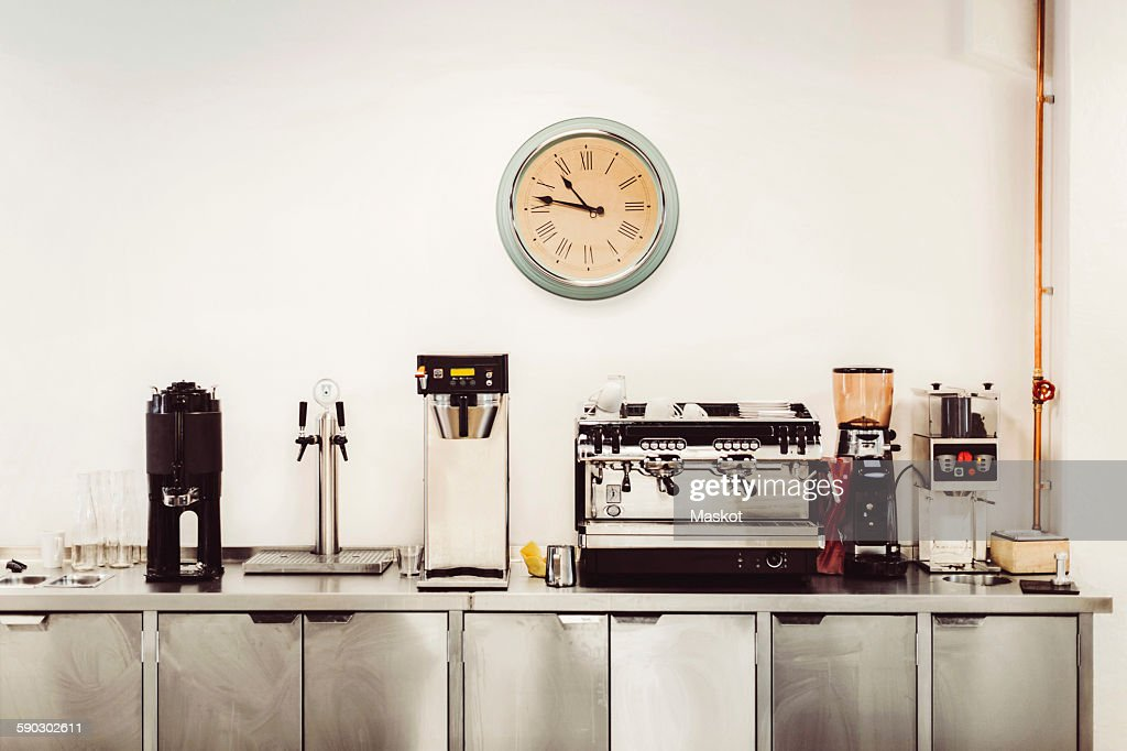Various coffee makers on commercial kitchen counter : Stock Photo