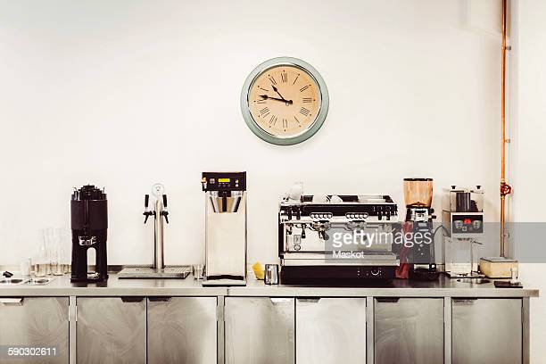 Various coffee makers on commercial kitchen counter