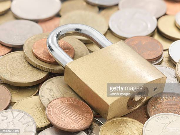 Various coins and padlock