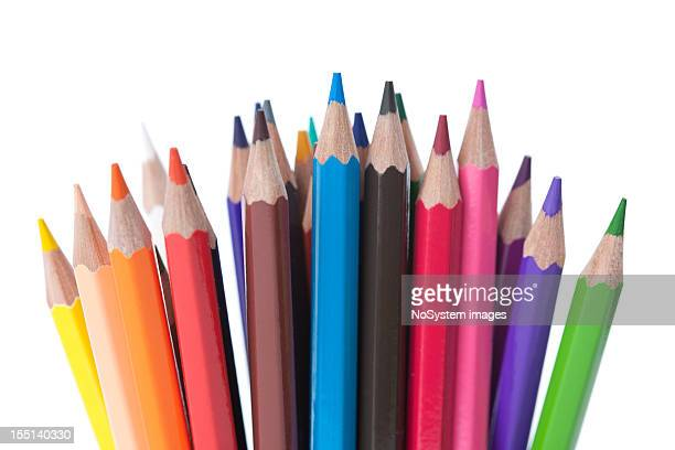 21 various colored pencils on a white background
